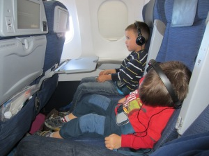 Kids sleeping on a plane