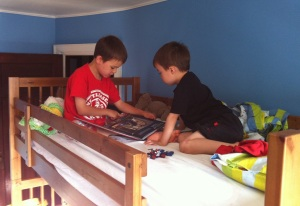 Siblings kids reading bunk beds